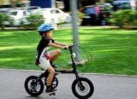 Toddler on bike wearing a helmet